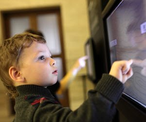 A child tries out an exhibit at The Children's Museum, Edinburgh