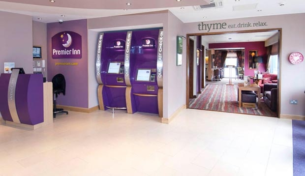 Reception area leading into Thyme restaurant inside Premier Inn Camberley hotel
