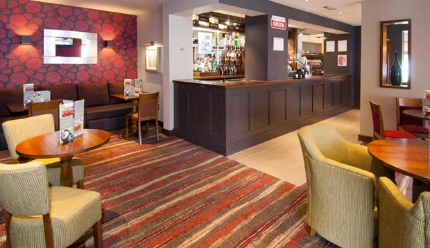 Bar area with seating inside Premier Inn Camberley hotel