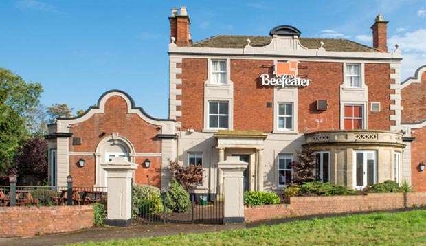 View of refurbished Beefeater restaurant next to Premier Inn Cannock South hotel from the front.
