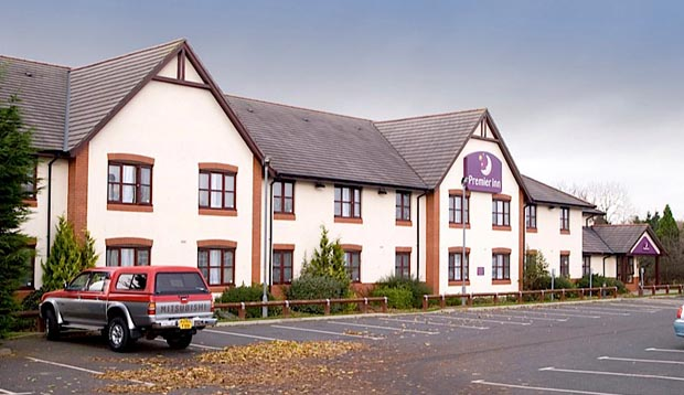 Exterior of Premier Inn Carlisle hotel with car park