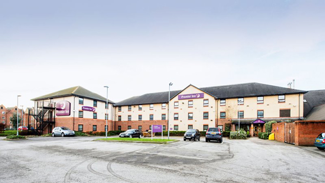 Premier Inn Chesterfield North hotel - view from the road showing lots of free parking spaces outside
