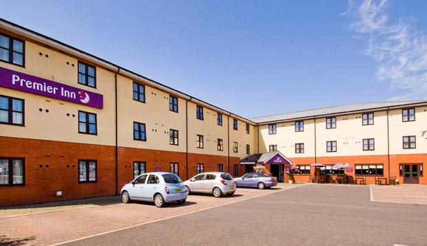 Exterior of Premier Inn Hotel Chichester showing carpark