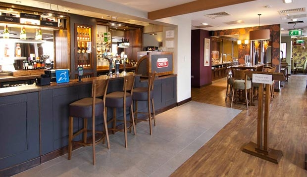 Bar area with restaurant seating in the background at Premier Inn Coventry City Centre hotel