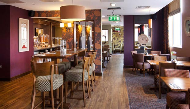 Tables laid for breakfast at Premier Inn Coventry hotel.