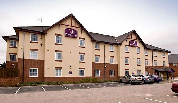 Exterior of Premier Inn Coventry East (M6,Jct2) with car park view