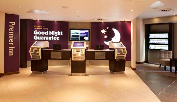 View of self check-in desks in the reception area at Premier Inn Croydon Town Centre hotel