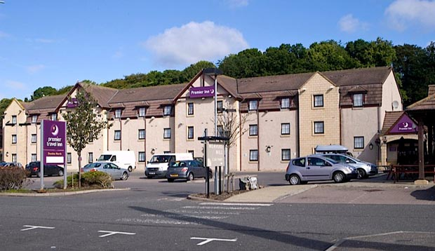 Exterior of Premier Inn Hotel Dundee North showing car park