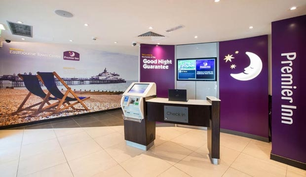 Reception area with self check-in kiosks at Premier Inn Eastbourne
