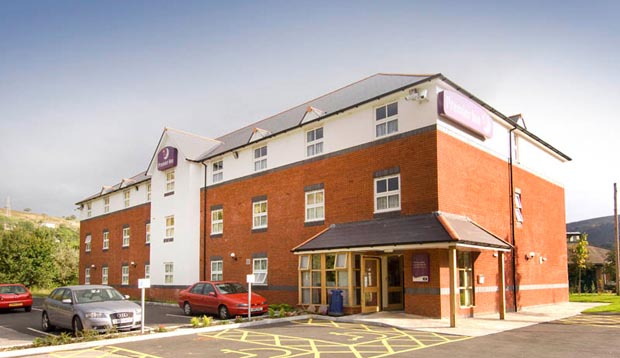 Exterior of Premier Inn Ebbw Vale showing car park and reception