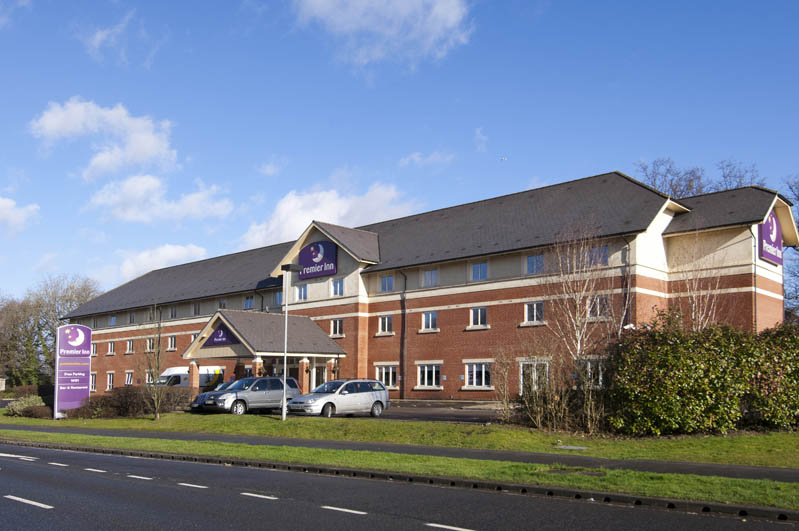 Exterior at Premier Inn Gatwick Crawley Town West showing car park and surrounding area