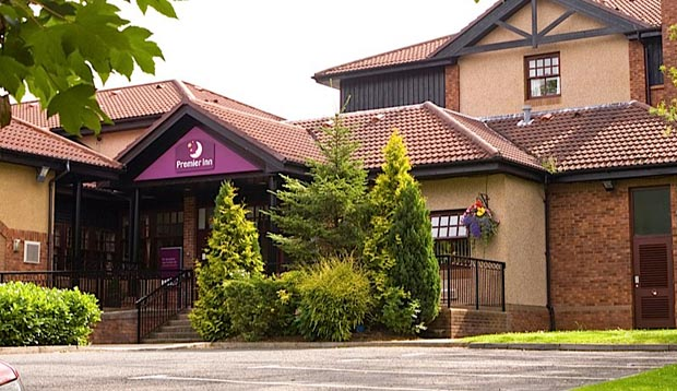 Exterior of Premier Inn Glasgow East showing surrounding greenery