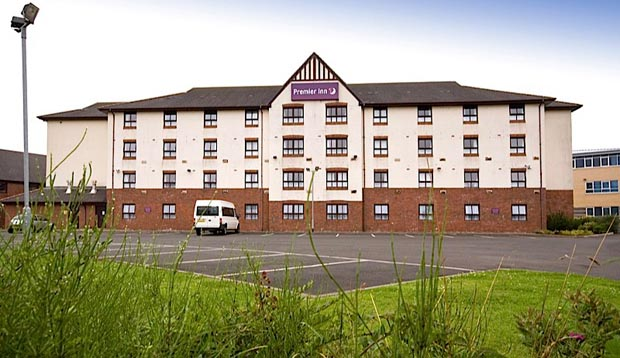 Exterior of Premier Inn Glasgow Stepps (M80, J3) showing car park