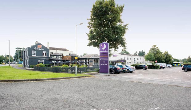Exterior of Premier Inn Gloucester (Longford) showing car park
