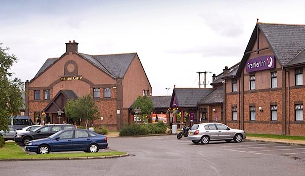 Car park area and exterior at Premier Inn Inverness East