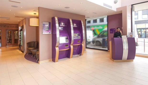 Reception at Premier Inn Leeds City Centre (Leeds Arena) hotel with self check-in kiosks