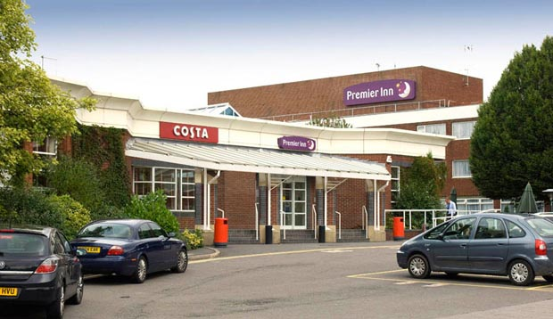 Car park and exterior of Premier Inn Leicester Fosse Park hotel