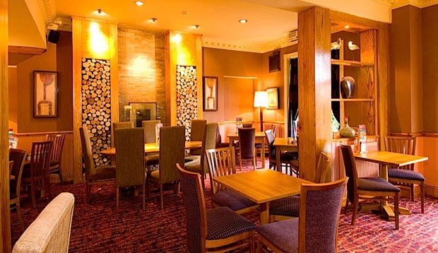 Restaurant area at Premier Inn Liverpool (Roby) hotel