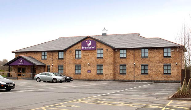 Exterior at Premier Inn Llanelli Central West hotel showing car park