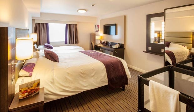 Family room layout in Premier Inn London Hackney hotel with pull out bed for kids plus cot