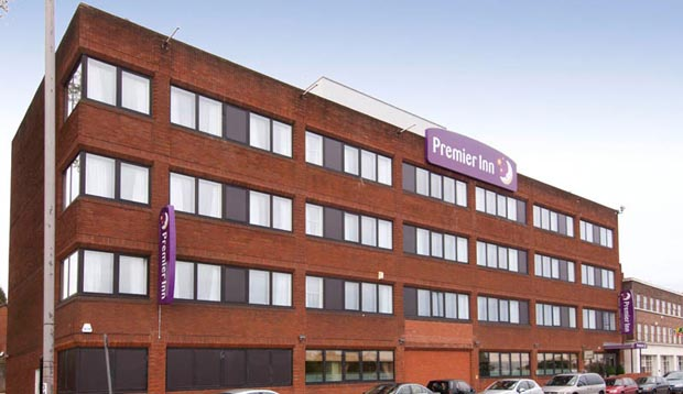 Exterior of Premier Inn London Hanger Lane showing car park