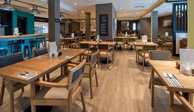Tables set out in Thyme restaurant at Premier Inn Tottenham Hale
