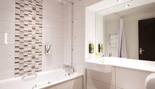 Standard bathroom with shower over bath at Tottenham Hale hotel