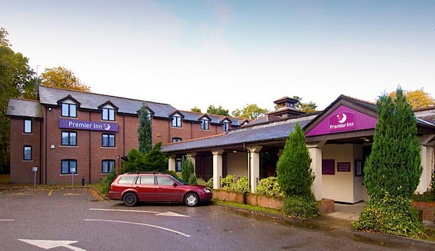 Exterior at Premier Inn Manchester (Wilmslow) hotel showing car park and reception