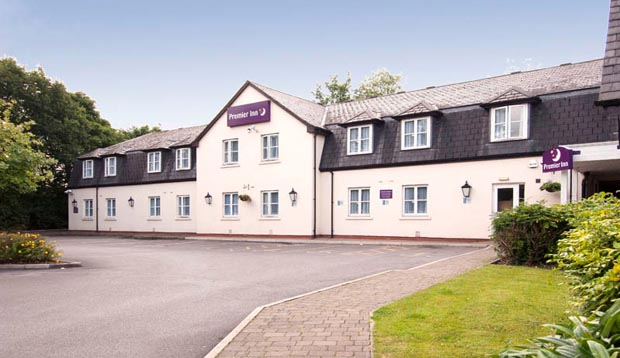 Exterior at Premier Inn Manchester (Handforth) hotel showing surrounding gardens