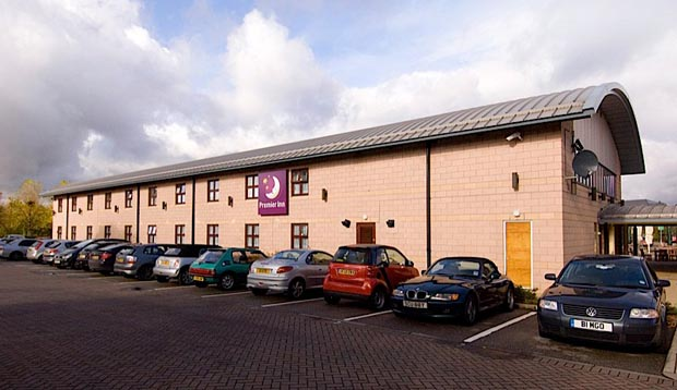 Exterior of Premier Inn Manchester (Cheadle) hotel showing car park and exterior