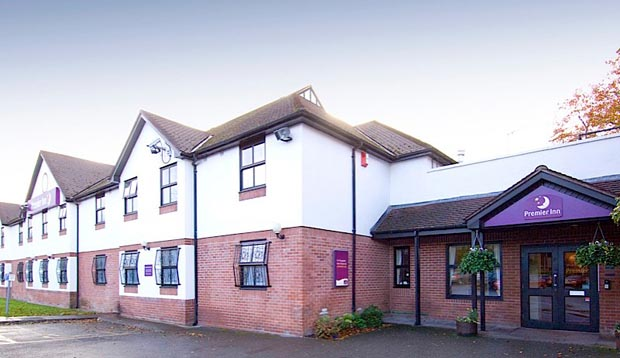 Exterior at Premier Inn Manchester Airport (Heald Green) hotel showing reception
