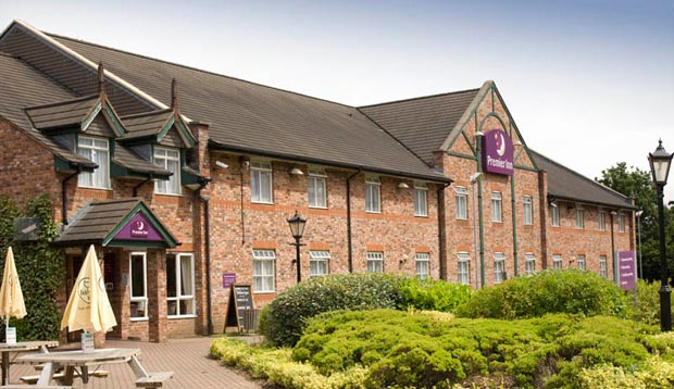 Exterior at Premier Inn Manchester (Sale) hotel showing surrounding gardens and restaurant area