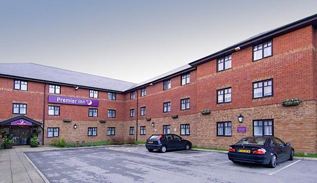 Car park and exterior of Premier Inn Manchester (Hyde) hotel