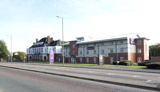 Exterior of Premier Inn Manchester (Heaton Park) hotel with street view