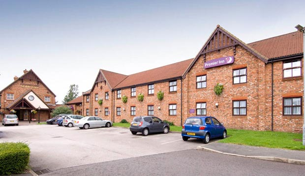 Car park and exterior at Premier Inn Manchester (Denton) hotel