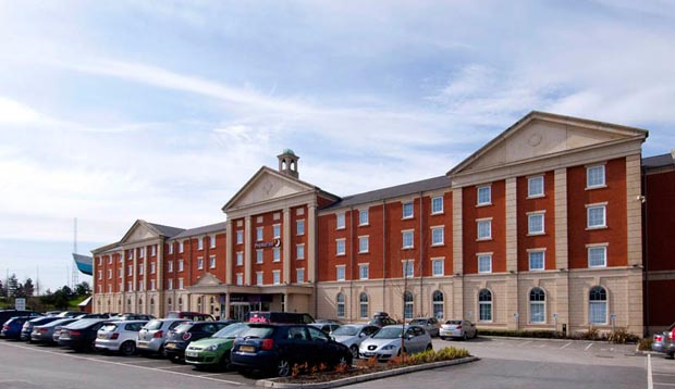 Car park and exterior of Premier Inn Manchester Trafford Centre West hotel