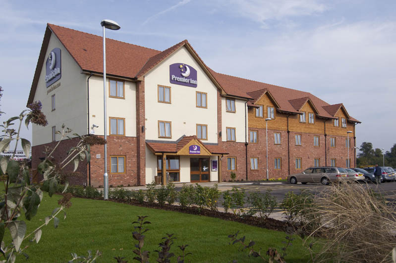 Exterior at Premier Inn Newport/Telford hotel showing surrounding gardens