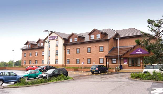 Exterior of Premier Inn Ripley showing car park