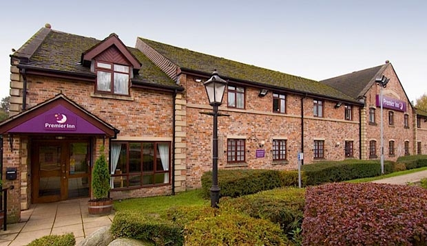 Exterior of Premier Inn Rochdale showing gardens