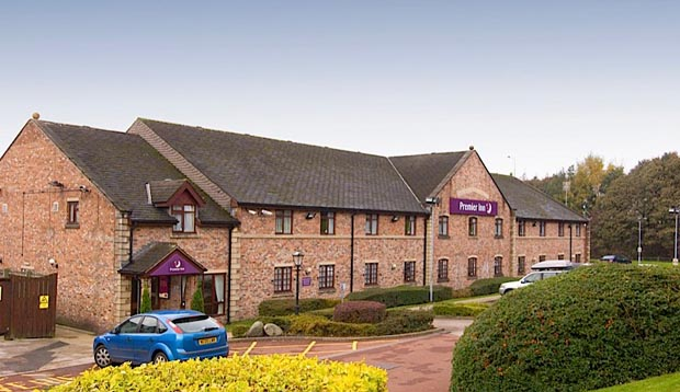 Exterior of Premier Inn Rochdale showing surrounding countryside and car park