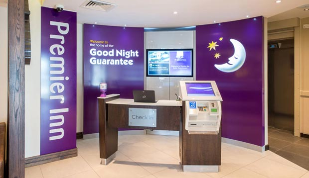 Reception at Premier Inn Tenby Town Centre showing self check in kiosks