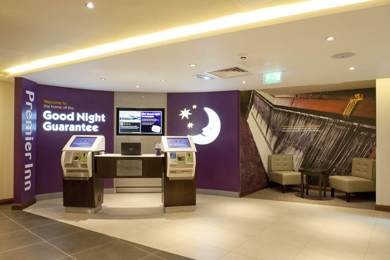 Reception area at Premier Inn Trowbridge showing self check in kiosks